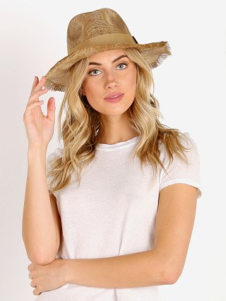 Model in gold Brixton Payton Hat