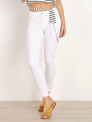 Model in white sateen J Brand Alana High Rise Crop Skinny