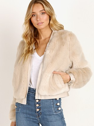 Model in champagne J Brand Ashbey Faux Fur Jacket