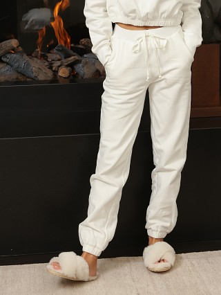 Model in white NIA Bradley Sweatpant