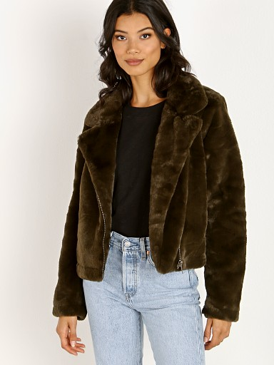Model in army green APPARIS Tukio Faux Fur Jacket