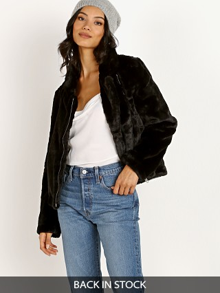Model in black APPARIS Tukio Faux Fur Jacket