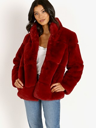 Model in ruby red APPARIS Sarah Faux Fur Jacket