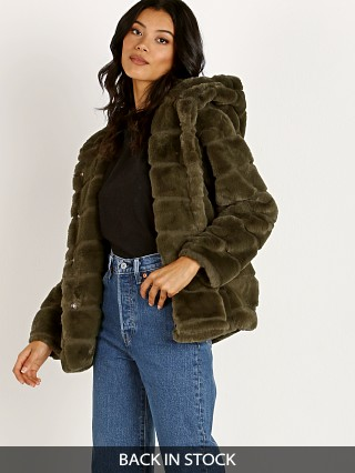 Model in army green APPARIS Goldie Faux Fur Jacket