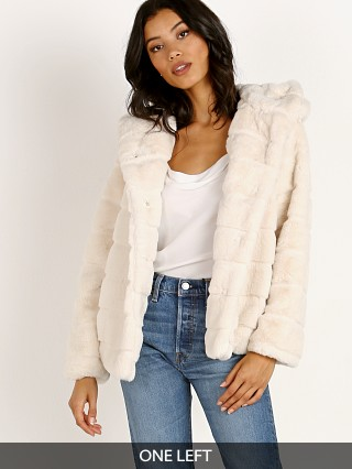 Model in ivory APPARIS Goldie Faux Fur Jacket