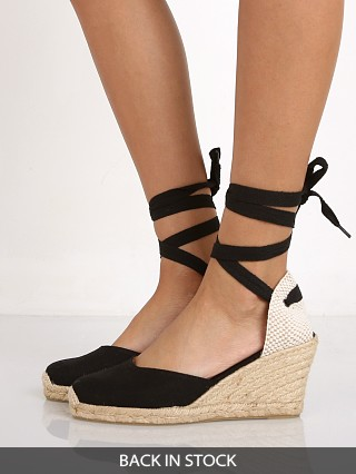 Model in black Soludos Tall Wedge Linen