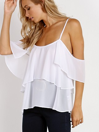 Model in white chiffon Show Me Your Mumu Romance Ruffle Top