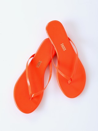 Model in neon orange Tkees Lily Flip Flop