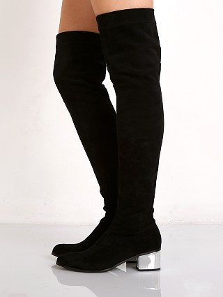Model in black with silver heel Sol Sana Aden Silver Heel Boot