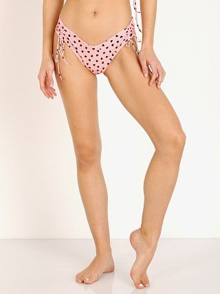 Model in pink hearts For Love & Lemons Claudia Scrunch Bikini Bottom
