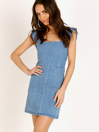 Model in amalfi blue Show Me Your Mumu Ruthie Ruffle Dress