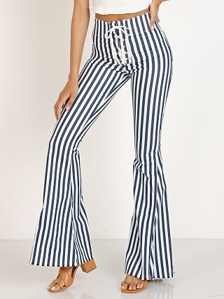 Model in nautical stripe Show Me Your Mumu Berkeley Tie Up Bells