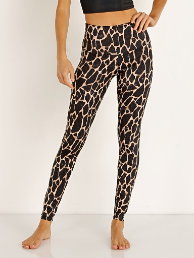 Model in giraffe Onzie High Rise Legging