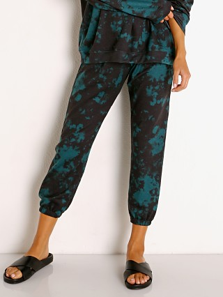 Model in emerald green Onzie Fleece Sweatpant  Tie Dye