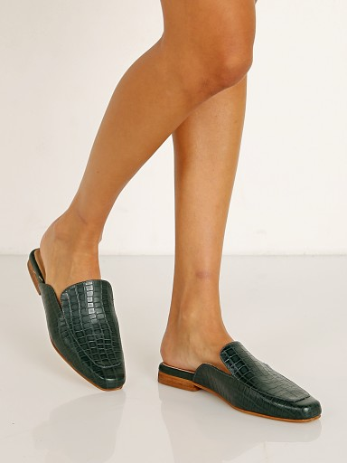 Model in emerald Kaanas Berlin Croc Embossed Square Toe Mule