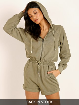 Model in washed army L Space Stay Cool Romper
