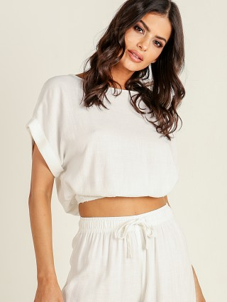 Model in white Stillwater The Pacific Crop Top