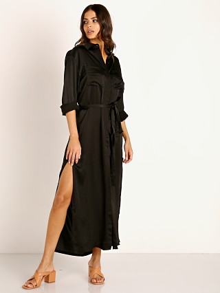 Model in black Stillwater The Darrian Shirt Dress