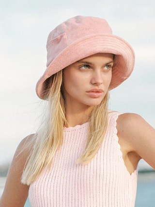 Model in pink terry Lack of Color Wave Bucket Hat