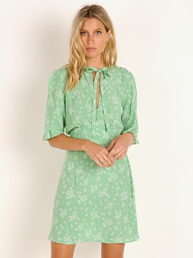 Model in vibrant green Auguste the Label Maeve Mimi Mini Dress