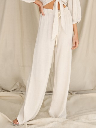 Model in natural linen Stillwater The Playa Wide Leg Pant
