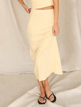 Model in baby yellow Stillwater The Classic Rib Skirt