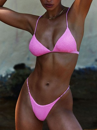 Model in crinkle pink IT'S NOW COOL Bralette Bikini Top
