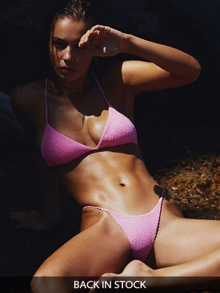 Model in crinkle pink IT'S NOW COOL String Bikini Bottom
