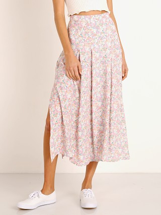 Model in vionettte floral Faithfull the Brand Cuesta Midi Skirt