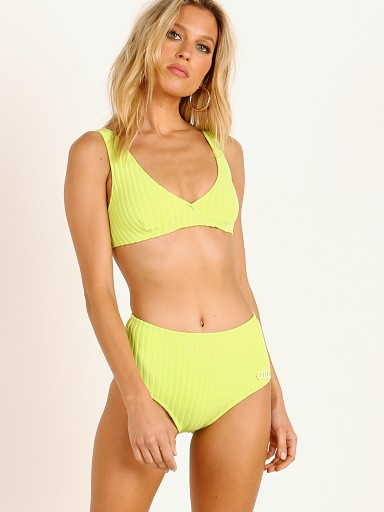 Model in chartreuse rib Solid & Striped Beverly Bikini Top
