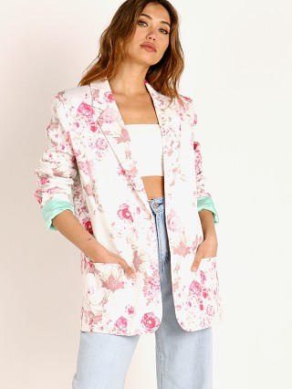 Model in pink floral For Love & Lemons Weston Denim Blazer