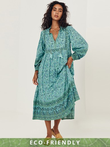 Model in turquoise Spell Sundown Boho Maxi Dress
