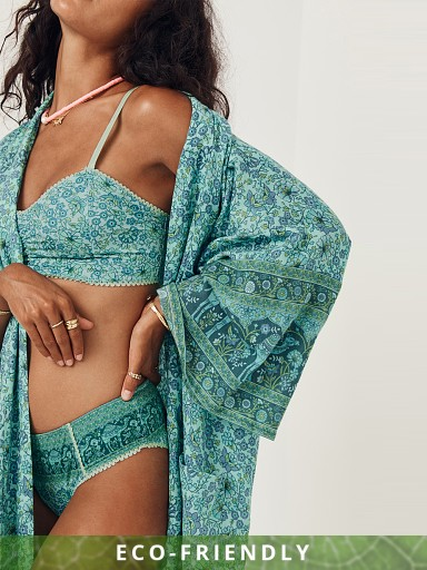 Model in turquoise Spell Sundown Maxi Robe