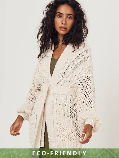 Model in cream Spell Taletha Cable Cardigan