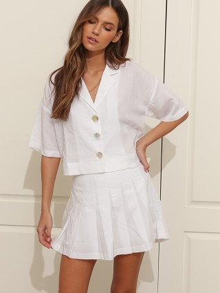 Model in white NIA Capri Shirt