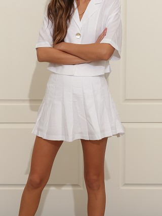 Model in white NIA Cannie Tennis Skort