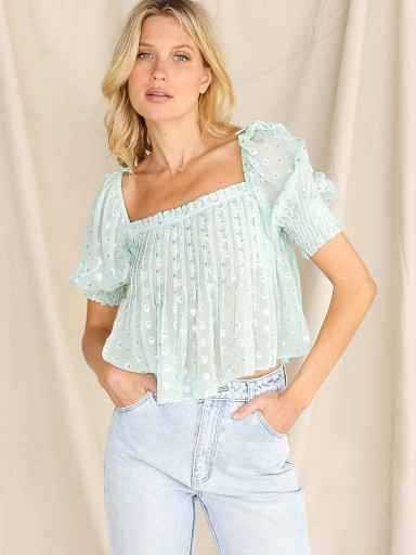 Model in mint For Love & Lemons Jana Blouse