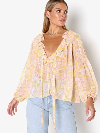 Model in pink For Love & Lemons Melanie Blouse