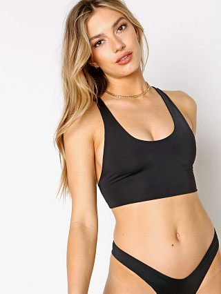 Model in black Indah Kimi Scoop Tank Bikini Top