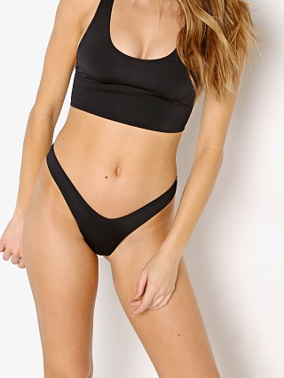 Model in black Indah Lesisure Med Coverage Bikini Bottom