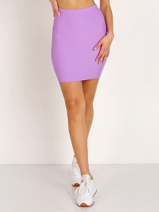 Model in lilac Indah Ramen Solid Mini Skirt
