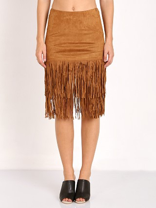Model in brown Wyldr Shimmy Shake Suede Skirt