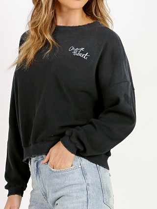 Model in black LNA Clothing Change of Heart Sweatshirt