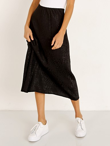 Model in black leopard LNA Clothing Jacquard Bias Cut Skirt