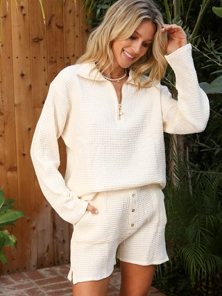 Model in cream DONNI. Waffle 1/2 Zip Pullover