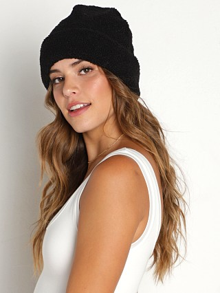 Model in black DONNI. Sherpa Beanie  w/ Pearl