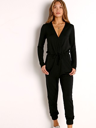 Model in black Beyond Yoga Cozy Fleece Jumpsuit