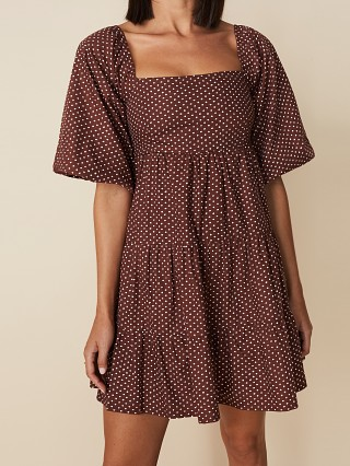 Model in bonnie dot Faithfull the Brand Eryn Mini Dress