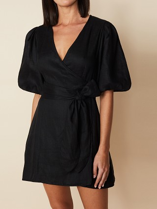 Model in black Faithfull the Brand Godiva Wrap Dress