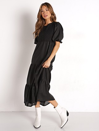 Model in black Faithfull the Brand Alberte Dress